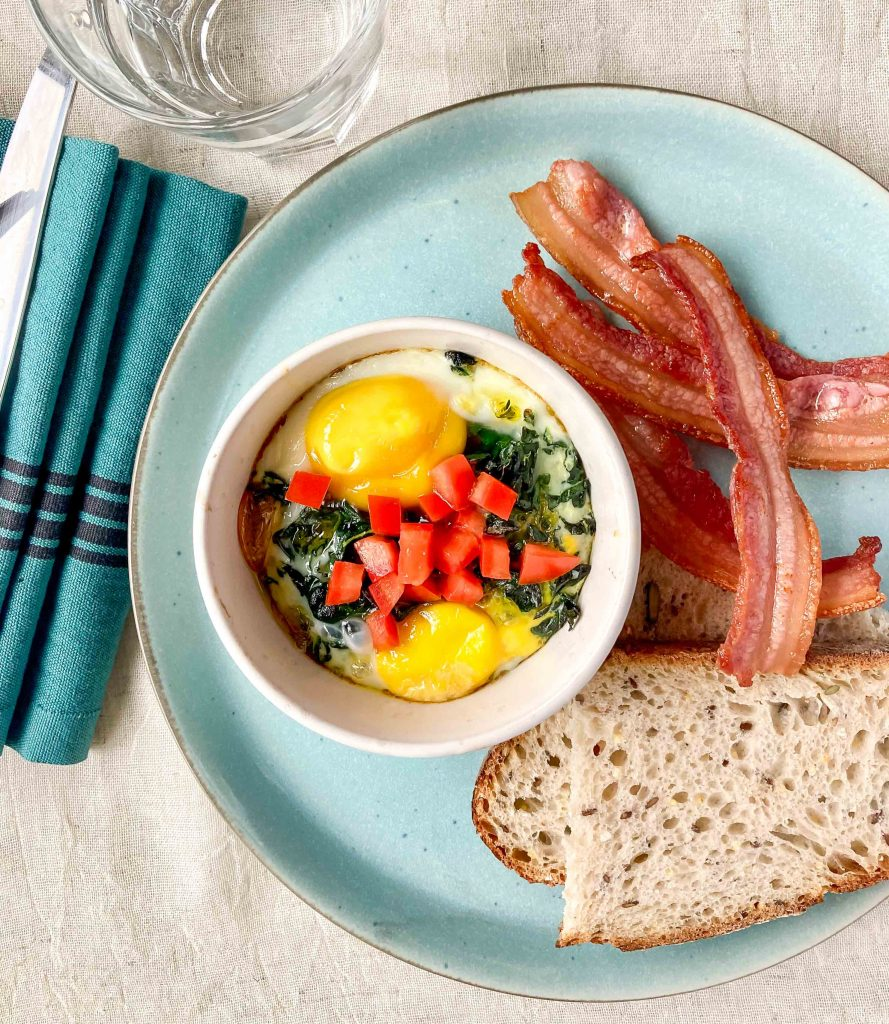 Baked eggs with tomato and kale